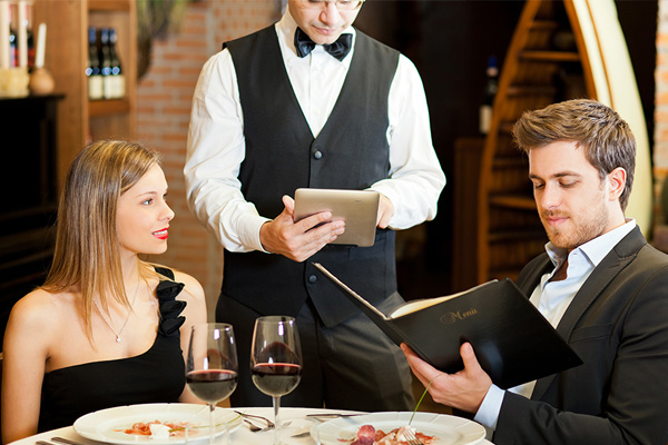 waiter taking order with ipad