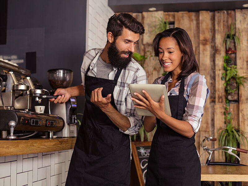 waitress using tablet computer