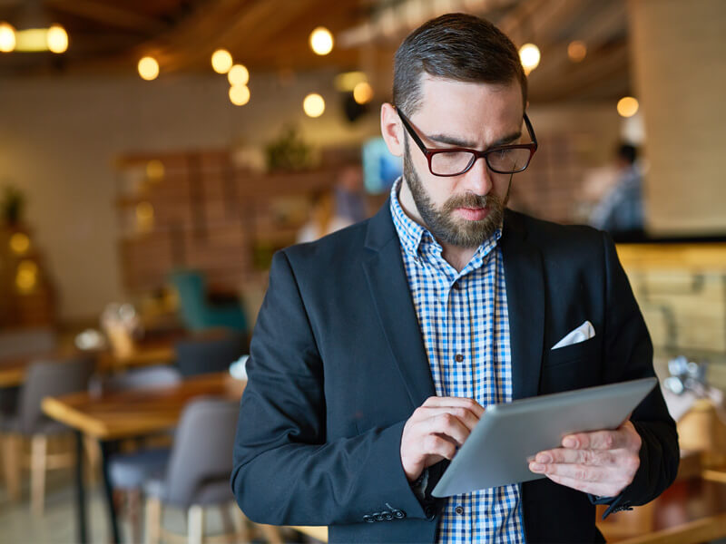 restaurant manager using apple ipad tablet